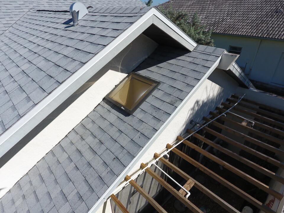 skylight on a shingle roof